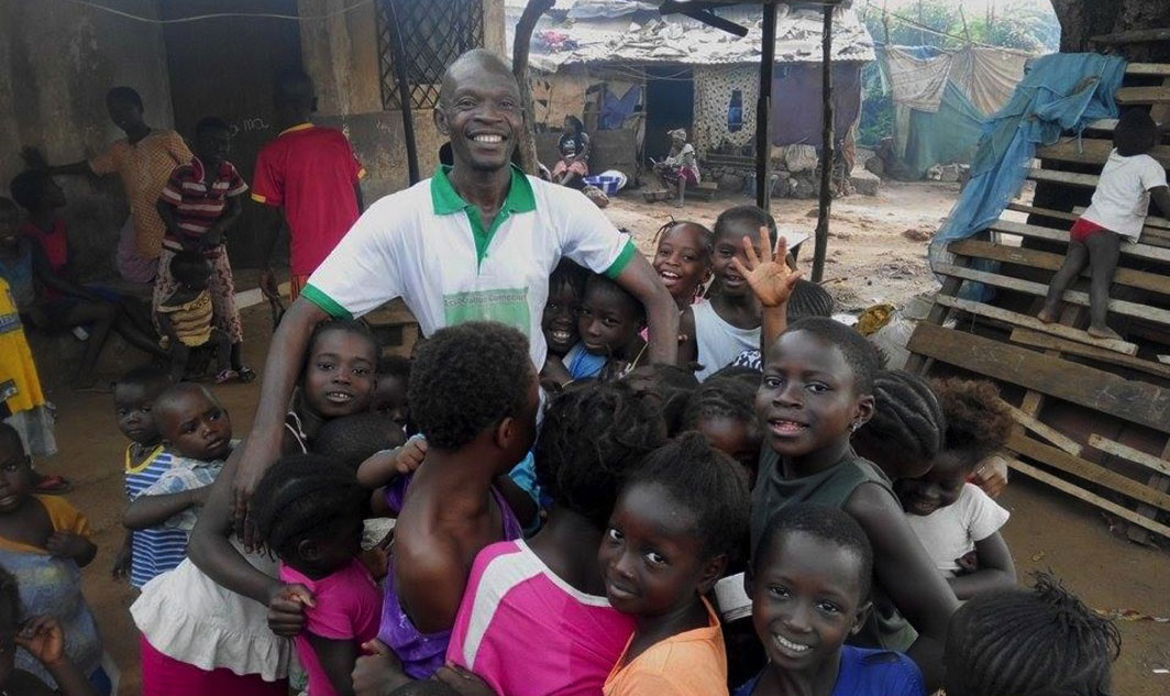 Our Co-Director Lamzo with some of the children he teaches, whose  parents can't afford school fees.