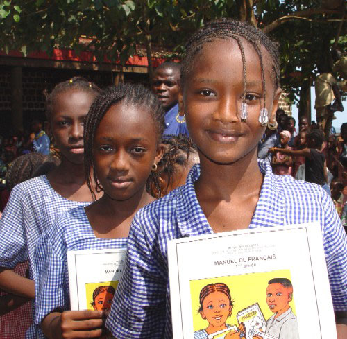 guinea school girls with books
